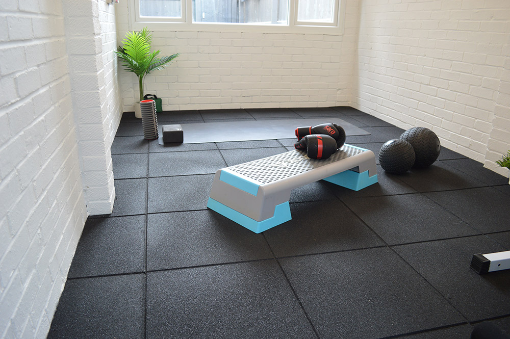 Gym location including workout bench and equipment